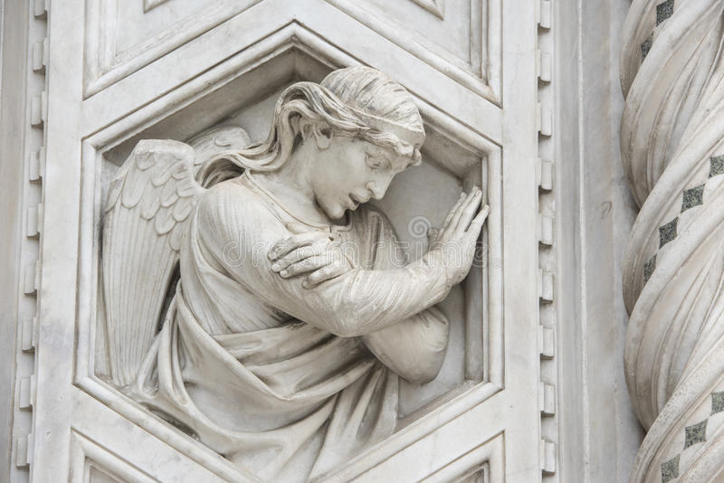 Angel on marble facade of Cathedral Florence royalty free stock images