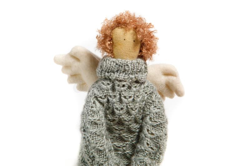 Angel handmade doll in sweater close up royalty free stock image