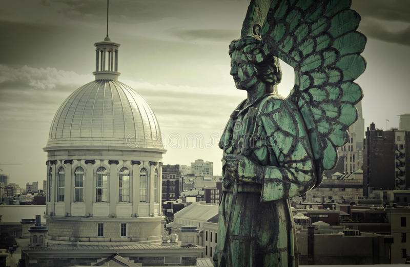 Angel monument. And the dome of Bonsecours market in old Montreal, Canada royalty free stock image