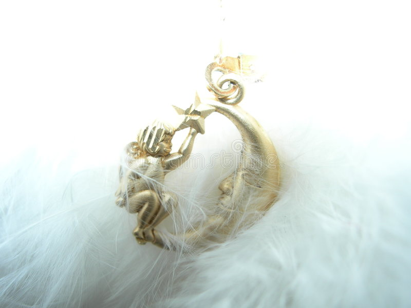 Angel and moon charm stock photo