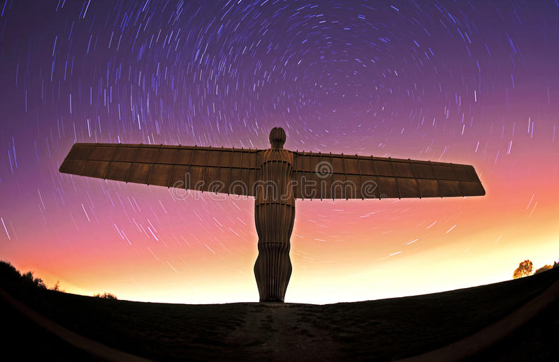 Angel of the north at night with star trails. A night shot of the angel of the north, taken at night using long exposures to create the star trials, it is a well stock photography