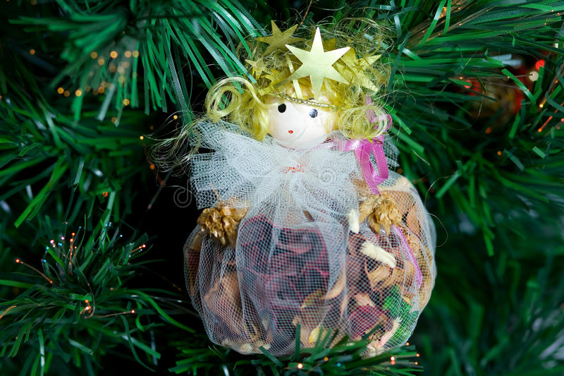 Angel ornament. A horizontal picture of a pretty handcrafted potpourri angel ornament on a Christmas tree stock photography