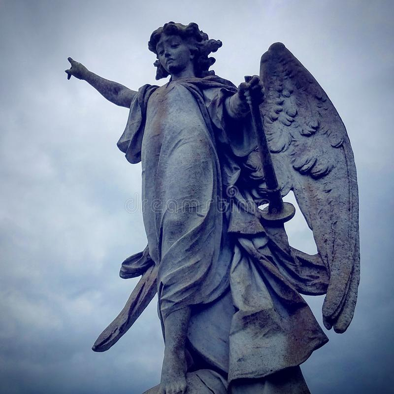 Angel Pointing Toward Heaven images stock