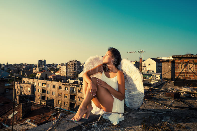 Download Angel on the roof stock photo. Image of wings, city, symbol - 33054802