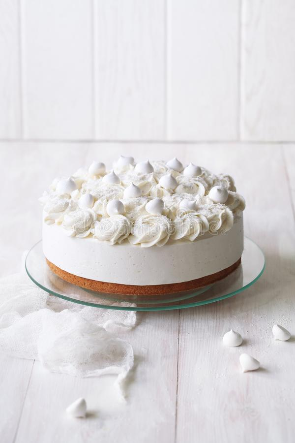 Angel`s Food Cake with Vanilla Souffle. And Meringue Cookies, on white wooden table stock photography