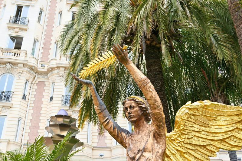 The angel sculpture with golden palm in Cannes royalty free stock photography