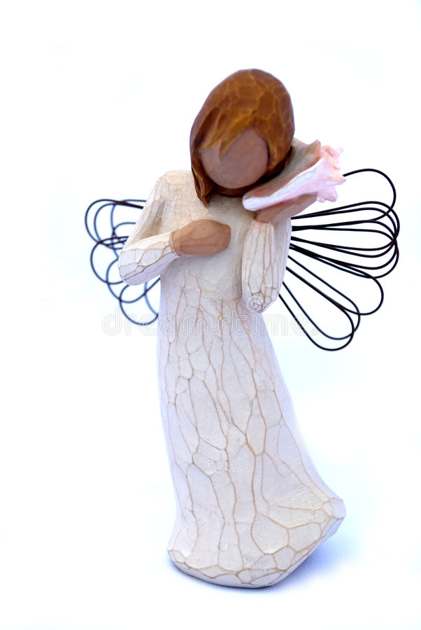 Angel with shell. Statuette of angel with shell on white background royalty free stock photography