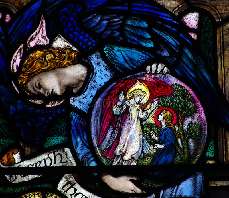 An angel showing the Annunciation in stained glass royalty free stock photography