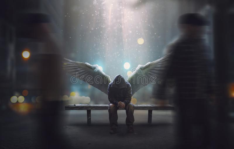 Angel left ignored. An angel sits on a bench as people pass by royalty free stock photography