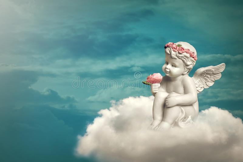 Angel sitting on the cloud stock photos
