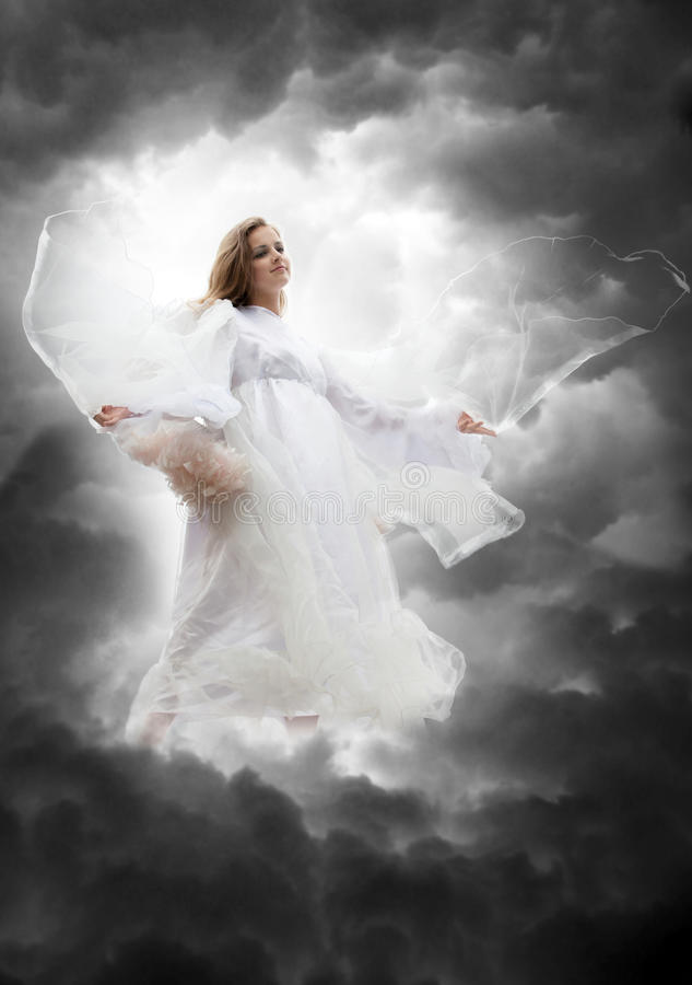 Angel in the sky storm royalty free stock photo