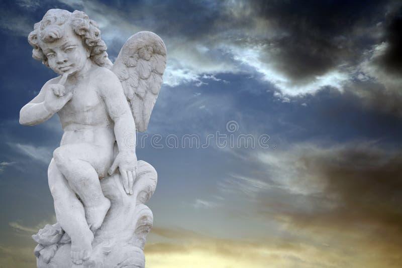 Angel with spooky sky stock photos