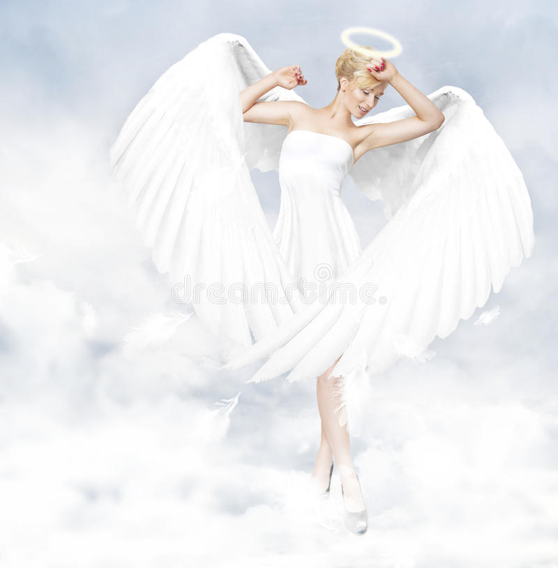 Angel standing in clouds stock image
