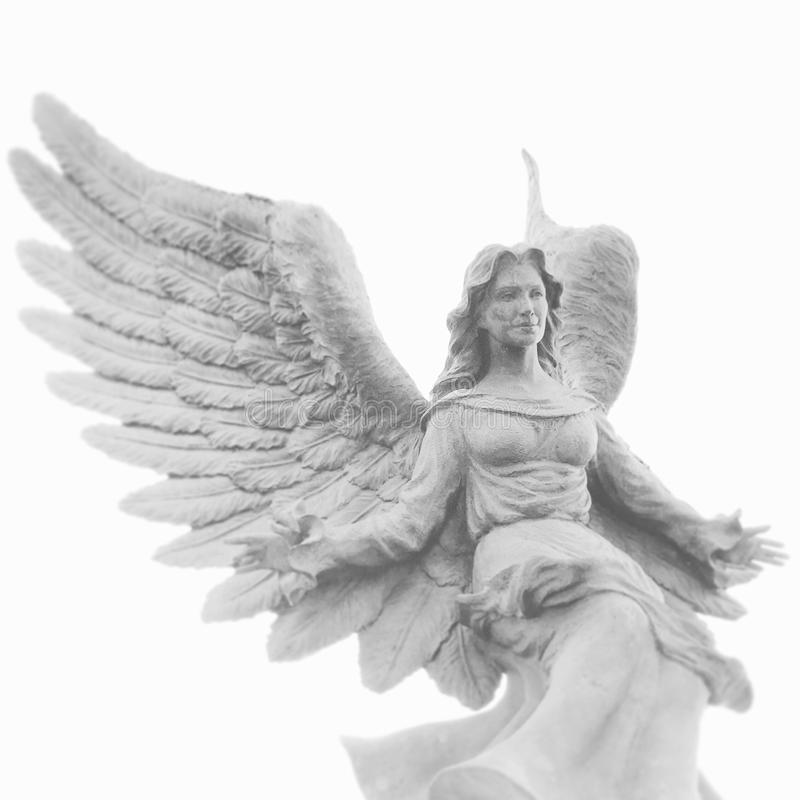 Angel Statue. A cold stoic angel statue looks down with peace stock photos