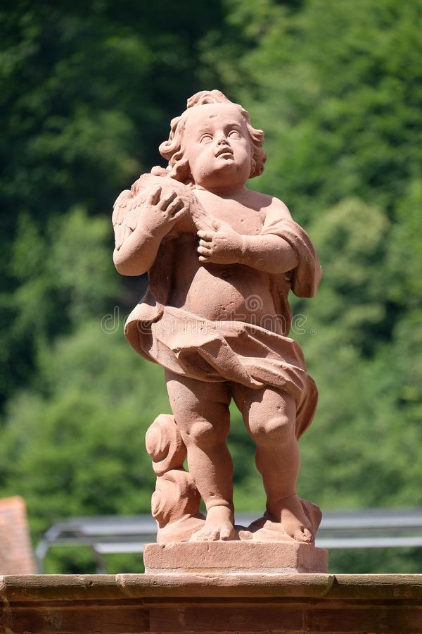 Angel, statue in the garden of cloister Bronnbach, Germany stock images