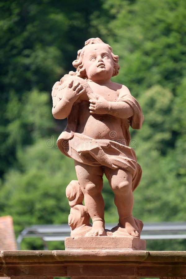 Angel, statue in the garden of cloister Bronnbach, Germany stock photography