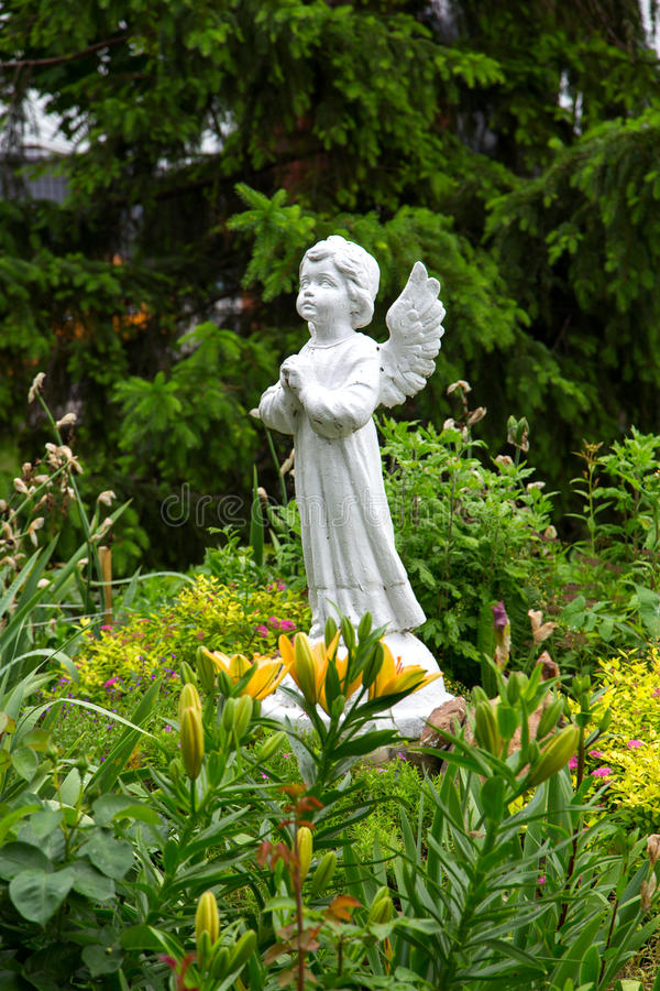 Angel statue in the garden royalty free stock image