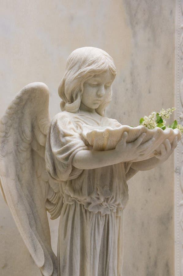Angel Statue Holding Baptismal Font V immagini stock