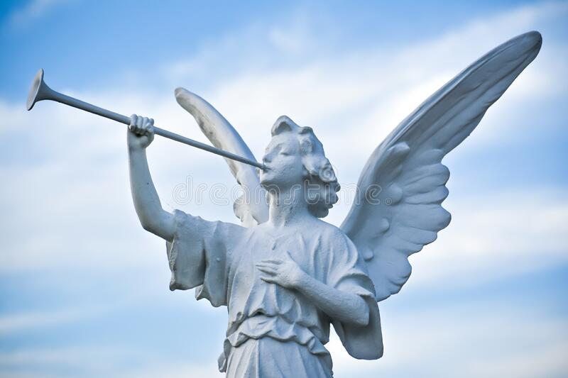 Angel Statue Blowing a Horn, Sky Background royalty free stock photos