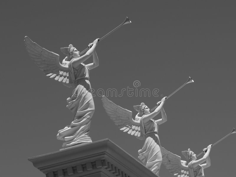 Angel Statues Blowing Trumpets stock photo
