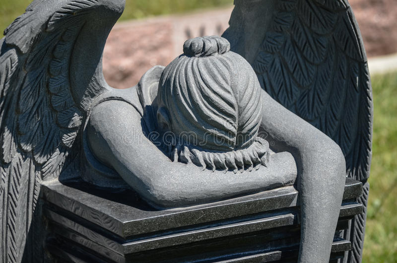 Angel Tombstone. Tombstone of angel praying and crying in grief stock images