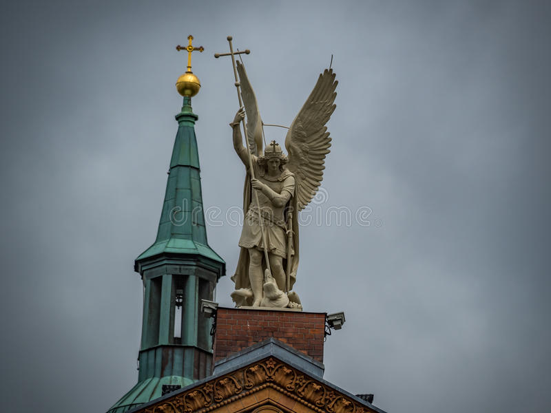 Angel on top of a tower. Statue of an Angel on the top of Saint Michael's church in Berlin royalty free stock photography