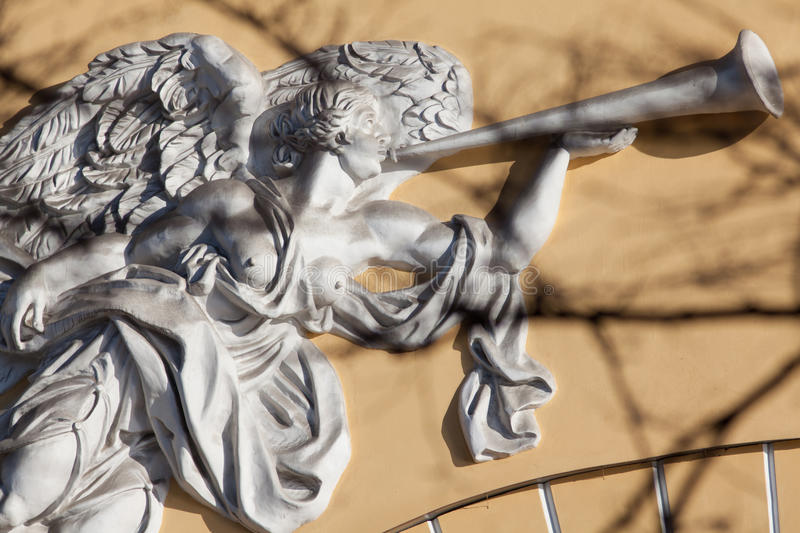 Angel with trumpet stock photography