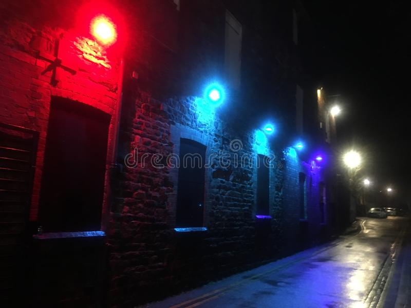 Angel. View at night east along Angel Street, Northampton. Red, blue, purple and yellow lights illuminate the scene. Observed in Winter royalty free stock images