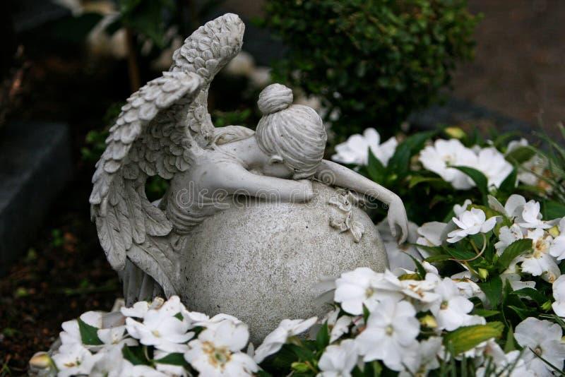 Angel weeping at gravestone stock image
