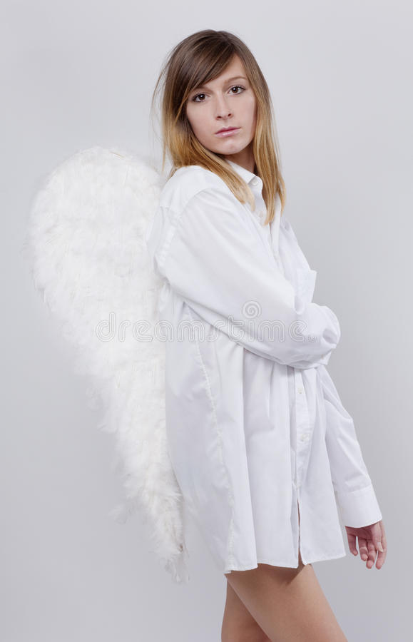 Angel with a white shirt stock image
