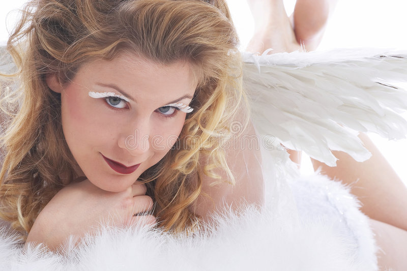 Angel with white wings stock images