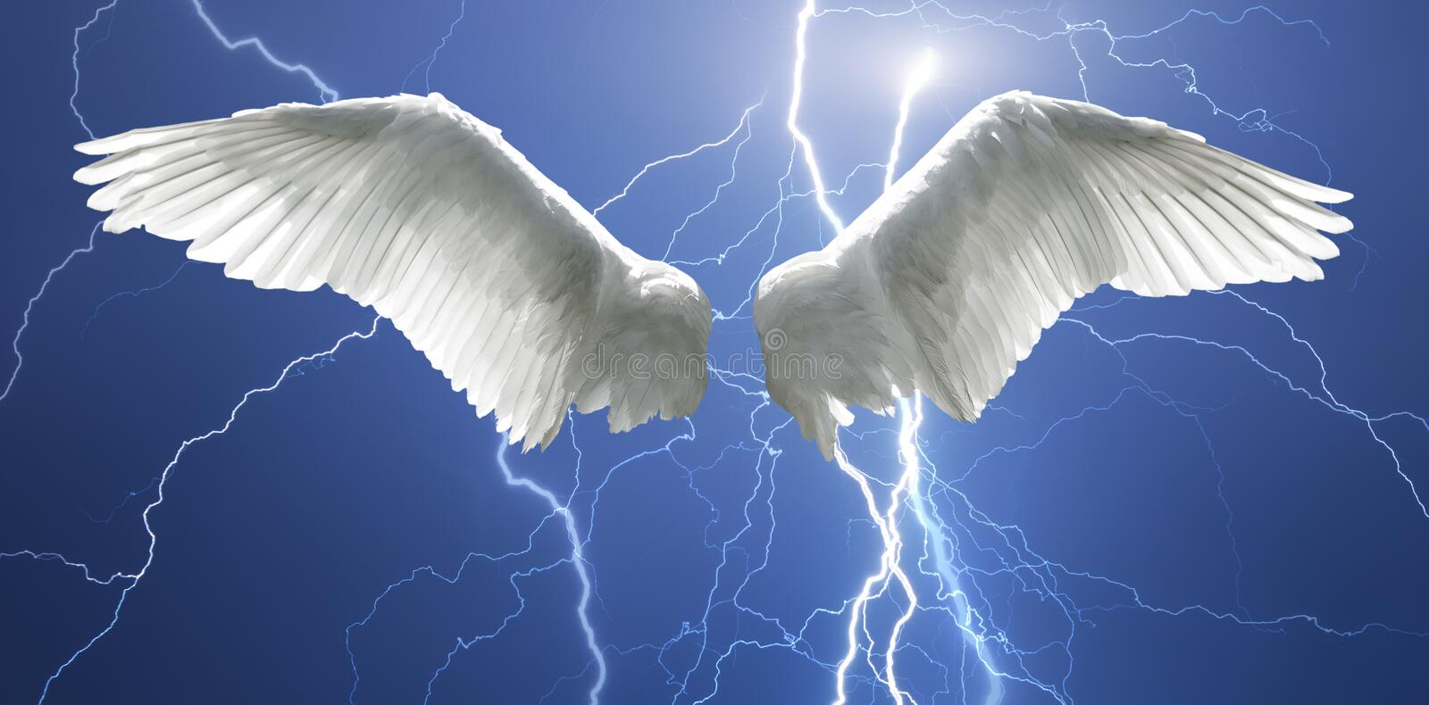 Angel wings with background made of sky and lightnings stock photo