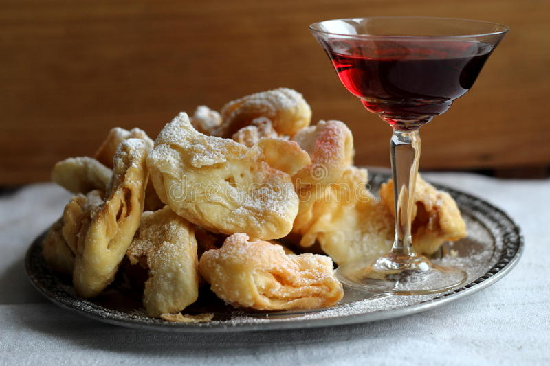 Angel wings (faworki) and red wine. Traditional Angel wings (faworki) and red wine stock image