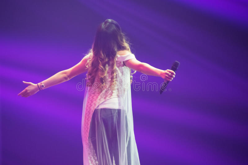 An Angel without wings. Live concert at Surabaya royalty free stock photo