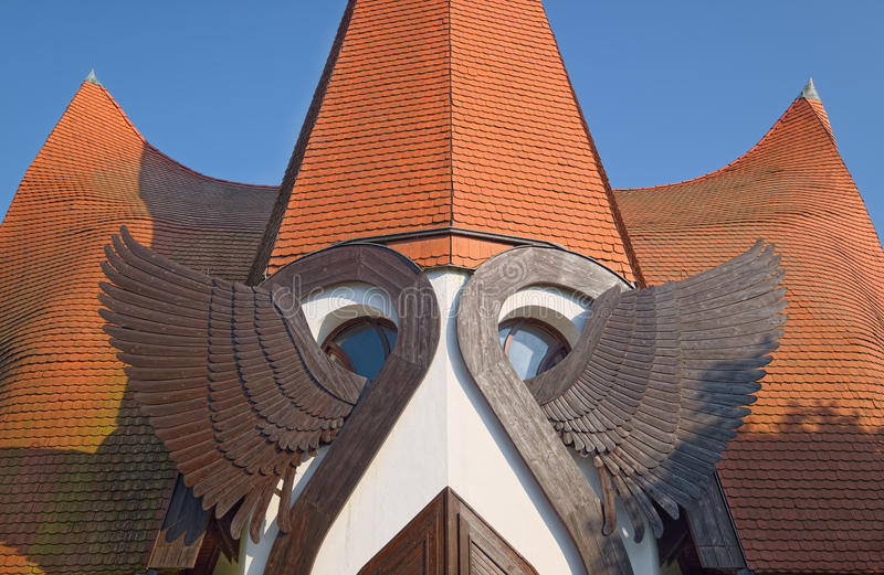 Angel wings of Lutheran Church of Siofok, Hungary. Wooden angel wings above the main entrance of Lutheran Church of Siofok, Hungary royalty free stock photo