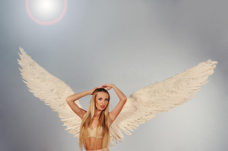 Angel with wings in the sky stock photography