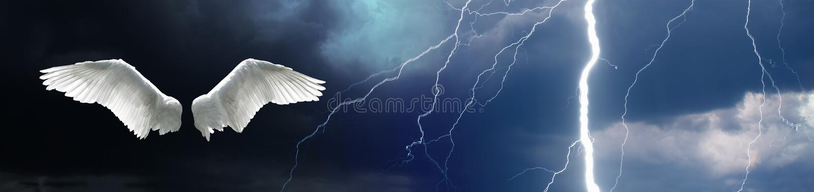 Angel wings with stormy sky background royalty free stock image