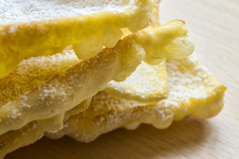 Angel wings: traditional sweet crisp pastry for carnival time royalty free stock images