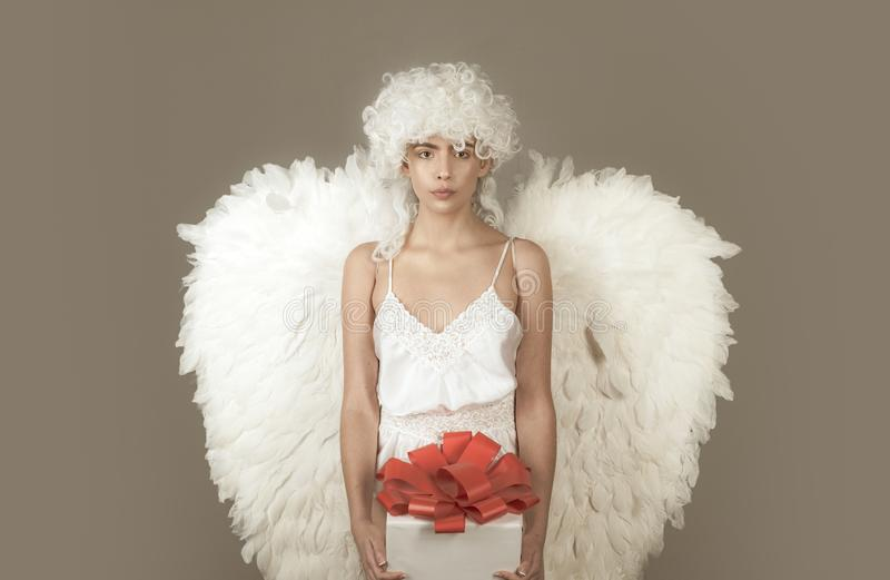 Angel woman with wings isolated. Art photo of a Angelic beautiful woman. Girl with angel wings and a white dress. Angel stock photos