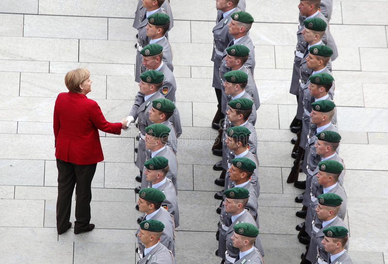 Angela Merkel. German Chancellor Angela Merkel greets a soldier before the arrival of Russian President Vladimir Putin at the chancellery in Berlin, Germany stock images