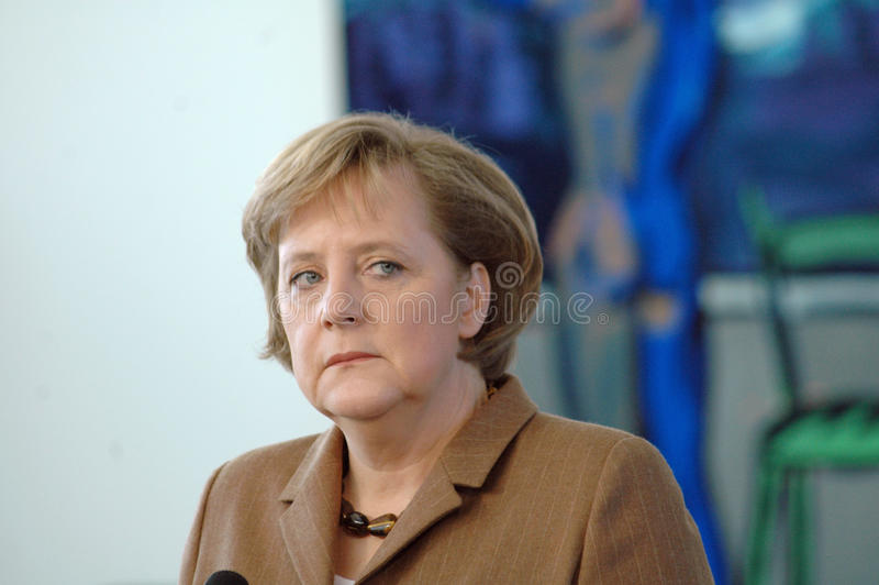 Angela Merkel. DECEMBER 7, 2006 - BERLIN: Chancellor Angela Merkel (in the background a painting by Rainer Fetting with the title Pilatus) during a reception in stock image