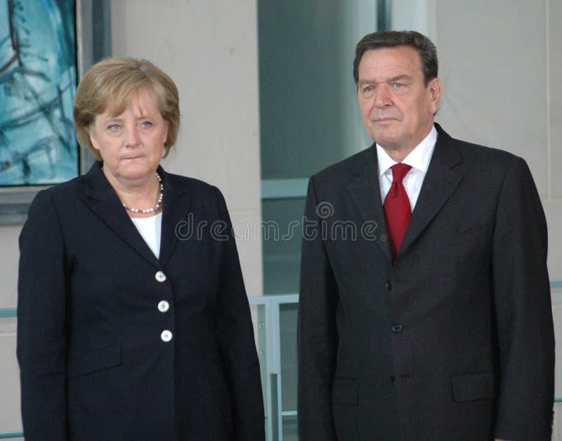 Angela Merkel, Gerhard Schroeder images stock