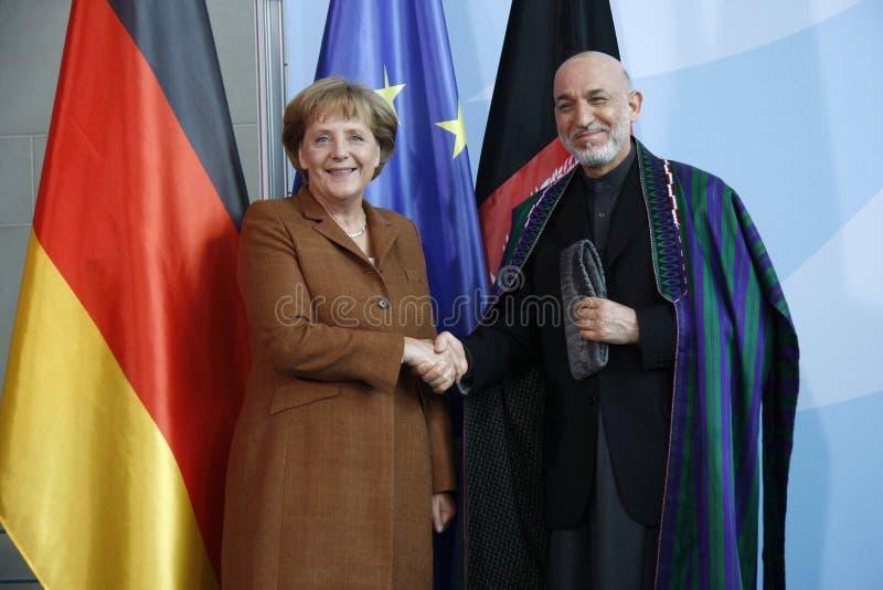 Angela Merkel, Hamid Karsai lizenzfreie stockfotos