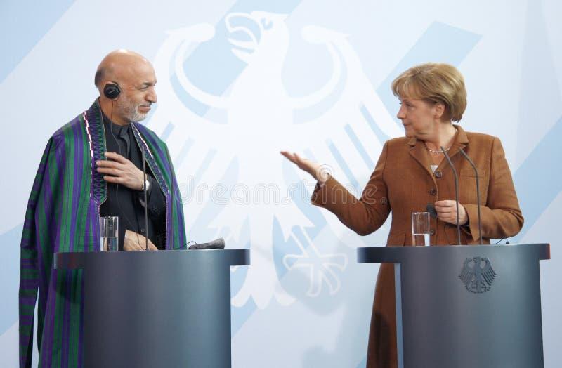 Angela Merkel, Hamid Karsai royalty-vrije stock afbeelding