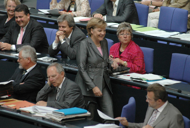 Angela Merkel. JUNE 29, 2006 - BERLIN: Chancellor Angela Merkel (in the background: Wolfgang Schaeuble and Sigmar Gabriel) during a parliamentary session in the stock photography