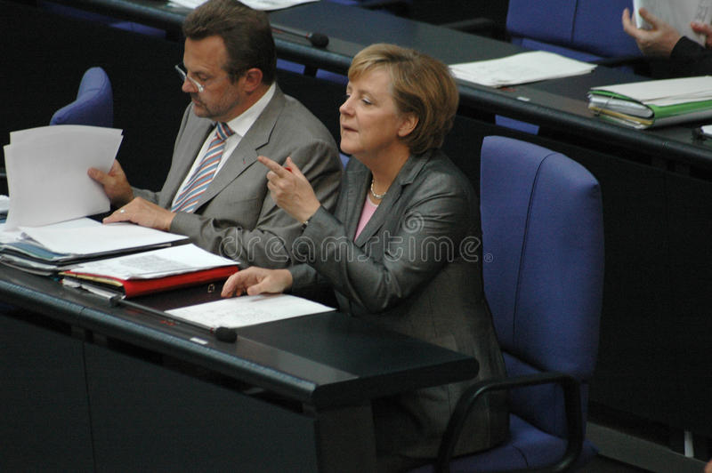 Angela Merkel. JUNE 29, 2006 - BERLIN: Chancellor Angela Merkel with an unidentified man during a parliamentary session in the German parliament, the Bundestag royalty free stock photos