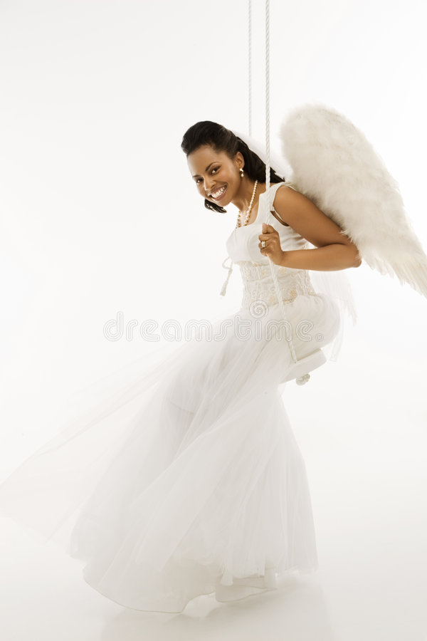 Angelic bride on swing. stock photo. Image of contact - 2849368