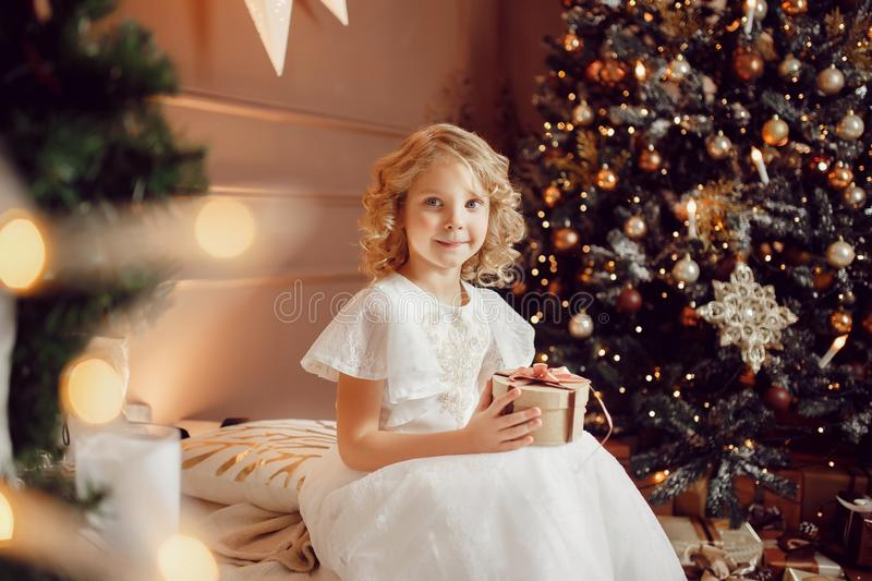 Girl child in beautiful Christmas decorated royalty free stock image