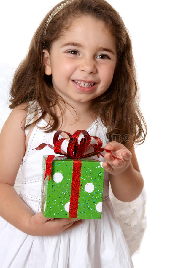 Download Angelic Girl Holding A Gift Stock Image - Image of adorable, present: 10460583