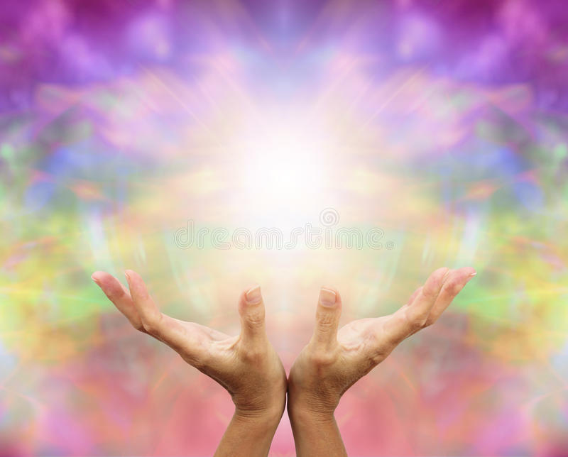 Angelic Healing Energy. Outstretched healing hands with angelic energy color background stock images